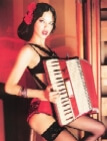 Supermodel Adriana Lima playing accordion